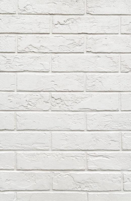 Белая кирпичная кладка из штукатурки
